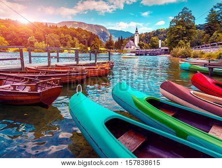 Bohinj Lake With Boats And Church Of St John The Baptist