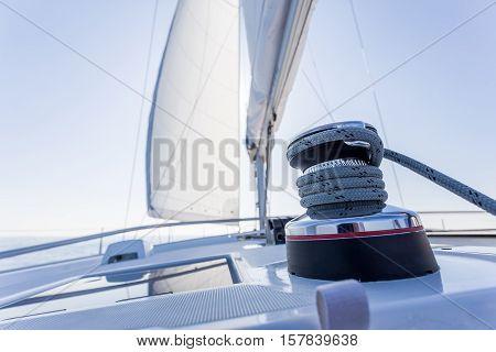 sail vessel surfing through the aegean sea