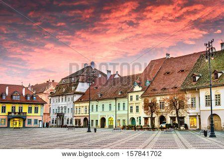 Sibiu Romania. Colorful clouds on sunrise Large Square in Sibiu Transylvania.