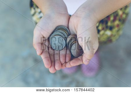 Coin in children hand. Business and finance concept