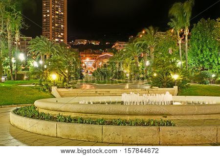 The evening walk in French style gardens of Monte Carlo locted opposite the Casino Square Monaco.