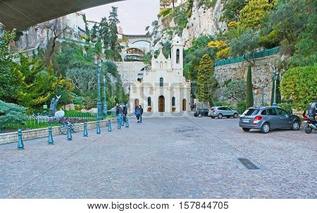 MONACO - FEBRUARY 21 2012: The Chapel dedicated to the patron Saint of Monaco - St Devota and surrounded by the green garden on the steep rocky slopes on February 21 in Monaco.