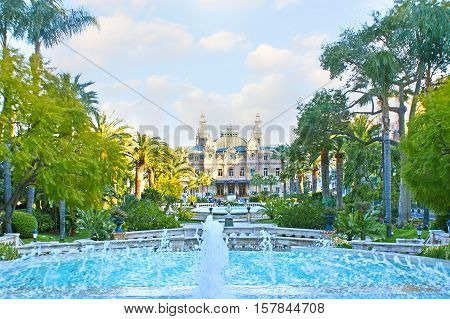 The gardens of Monte Carlo with shady alleys scenic fountains and fresh air are the best place to relax and enjoy the views of Salle Garnier - Opera of Monaco and famous Casino.