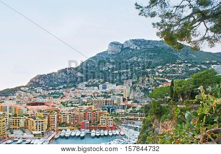 The Rock of Monaco-ville overlooks the Fontvieille ward with the New Port surrounding by modern residential quarters Monaco.