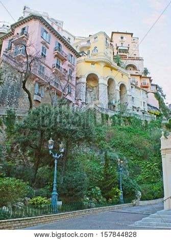 The rocky hill in St Devota street with the numerous residential buildings sandwiched to each other on its top Monaco.