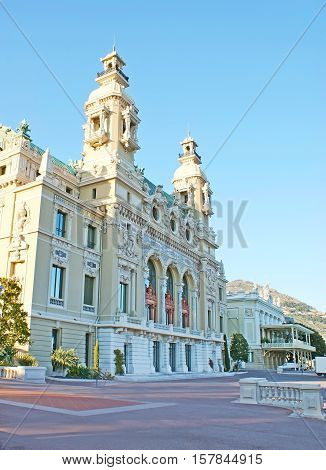 The facade of Salle Garnier - Opera of Monaco and its Casino with two towers and numerous sculptures located in Casino Square Monte Carlo ward.