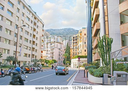 MONACO - FEBRUARY 21 2012: The residential street in La Condamine ward with the modern houses on the hilly area on February 21 in Monaco.