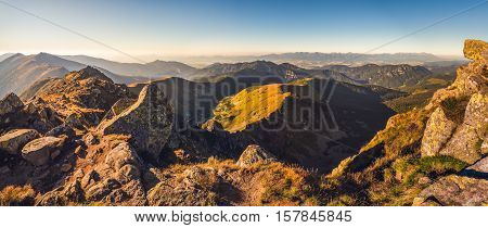 Evening Mountain Landscape with Rocks in Foreground. View from Mount Dumbier in Low Tatras National Park Towards High Tatras Mountains in Slovakia.