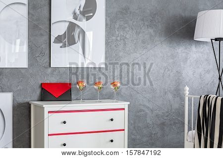 Grey Apartment With White Dresser