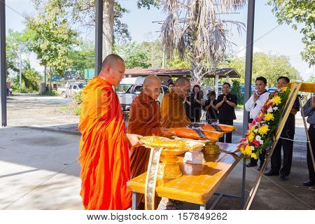 CHIANG RAI THAILAND - NOVEMBER 19 : unidentified Thai monks praying for dead man in front of the coffin on November 19 2016 in Chiang rai Thailand