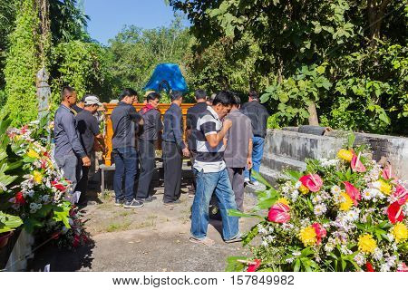 CHIANG RAI THAILAND - NOVEMBER 19 : unidentified Thai people looking at the dead man in the coffin for the last time on November 19 2016 in Chiang rai Thailand