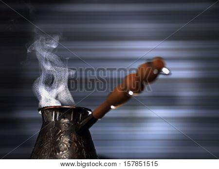 Turkish coffee pot. Blurred background. Arabica. robusta. Close-up