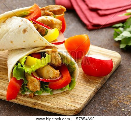 doner kebab with chicken and vegetables in a tortilla