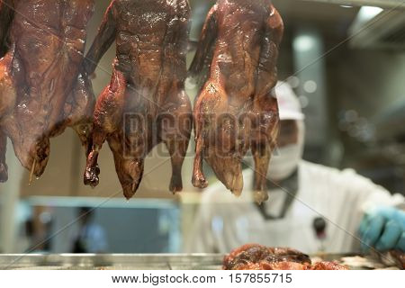 Roasted Peking Ducks Hung at a Chinese Restaurant