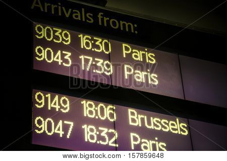 International arrivals board showing trains from Paris and Brussels