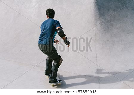 Young skateboarder at sunset at a skatepark