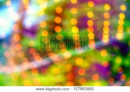 Red, orange, violet and green  holiday bokeh. Abstract Christmas background.