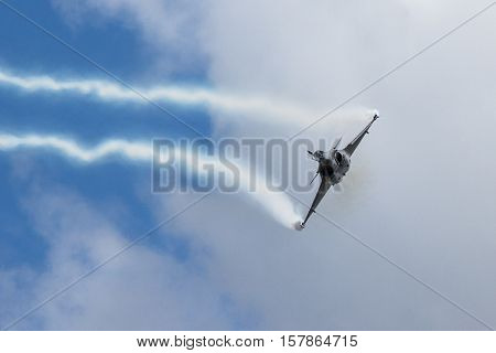Fighter Jet flying straight at camera with contrails