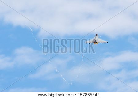 Fighter Jet flying away from camera with afterburners