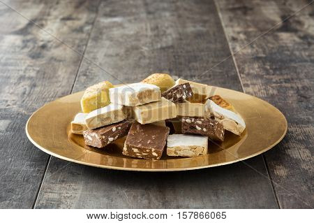 Christmas nougat on a golden plate isolated on white background