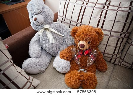 Toys Teddies and adult life. Valentine's day for lovers. Childhood memories with soft toys. Funny pictures with bears and glasses for two.
