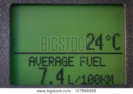 Car electronic display showing the average fuel consumption and the outside temperature.