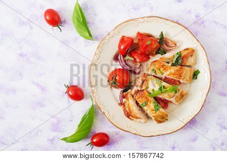 Grilled Chicken Breast Stuffed With Tomatoes, Garlic And Basil. Top View
