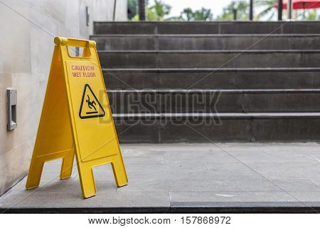 Yellow Wet Floor Warning Sign On The Floor In Hotel