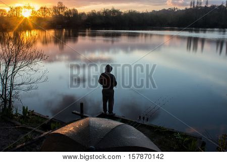 Sunrise with a Carp Angler overlooking Lake