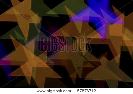 Bokeh vague colorful star shaped big scattered celebration lights on black background