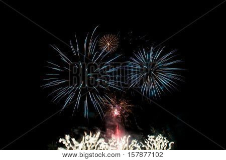 Colorful fireworks explode, Golden orange amazing fireworks isolated in dark background close up with the place for text, Malta fireworks festival, 4 of July, Independence day, New Year, explode