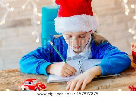 Child Writing A Letter To Santa Claus At Home.