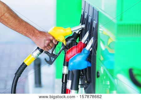 Close up of a person getting ready to pump gas