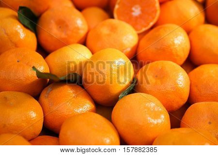 Tangerines background. Fresh oranges on market. Healthy fruits.