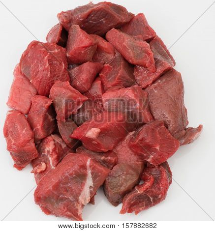 cut goulash of cattle meat on neutral background
