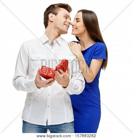 Valentine gift. Happy young couple with Valentine's Day present isolated on a white background