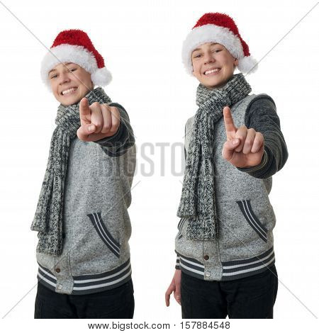 Set of cute teenager boy in gray sweater and christmas hat pointing forward over white isolated background, half body