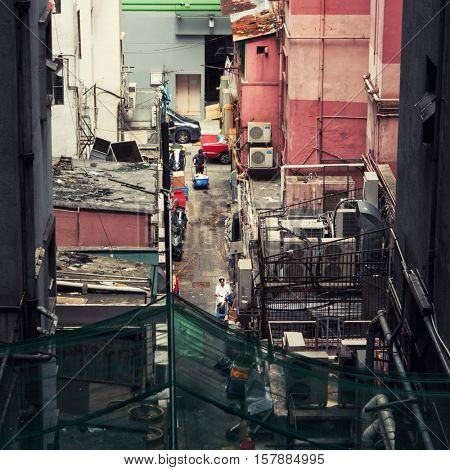 Hong Kong - October 2016: Elevated view of back alley with people. Kowloon