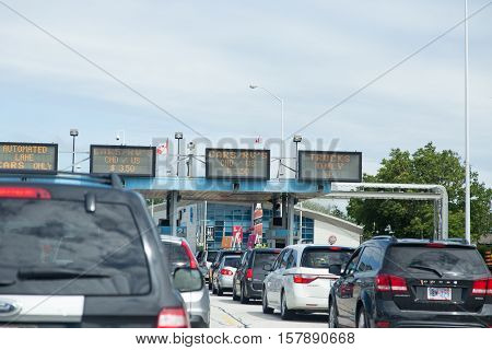 June 28 2015 Windsor Canada/Detroit US border. Cars line up at the border crossing between Canada and the USA