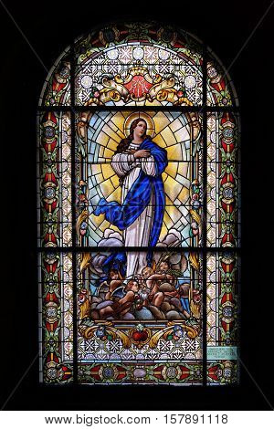 ZAGREB, CROATIA - JULY 02: Virgin Mary, stained glass window in the Parish Church of the Visitation of the Virgin Mary in Zagreb, Croatia on July 02, 2015.