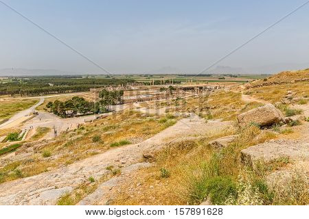 View from the hill of the ruins of old city Persepolis, a capital of the Achaemenid Empire 550 - 330 BC.
