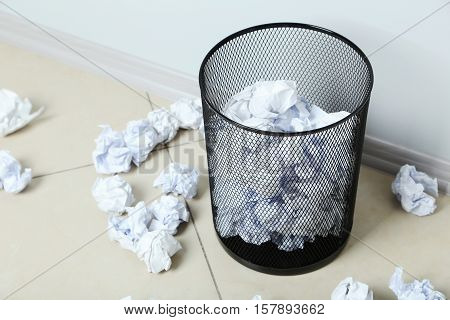 Office Trashcan With Crumpled Paper Balls On Grey Background