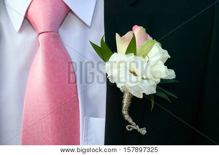 Groom with black suit and yellow flower bound on it