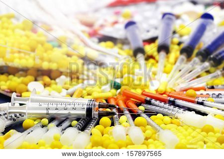 Pharmacy and medicine pills. Colorful medicine pills and syringes