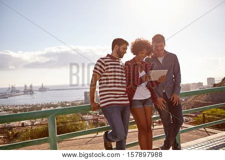 Three Friends Leaning Against A Railing