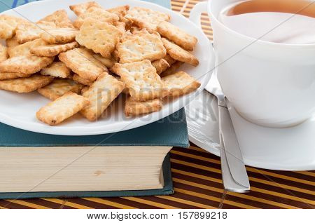 View Close-up On A Cup Of Tea And Dry Crackers