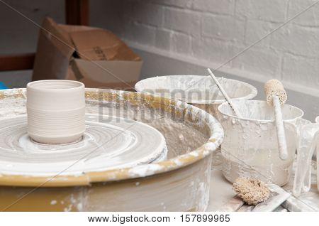 Pottery wheel and creative tools in the workshop
