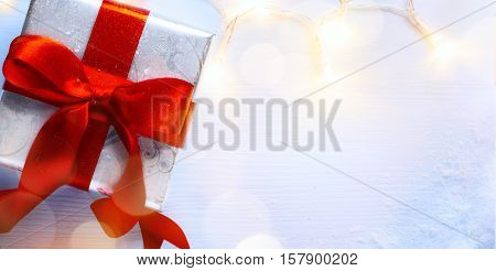 Christmas background; holidays gift box and Christmas decoration light; Top view copy space for your text