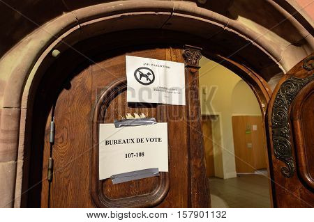 STRASBOURG FRANCE - DEC 06 2016: Bureaux de Vote - voting section election ofice paper on the door of the school vhere current election took place in France
