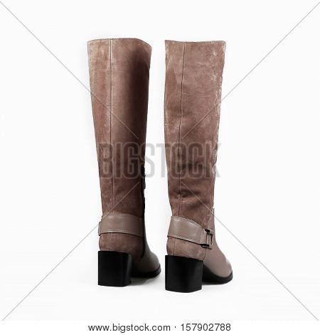 high female beige boots over white background